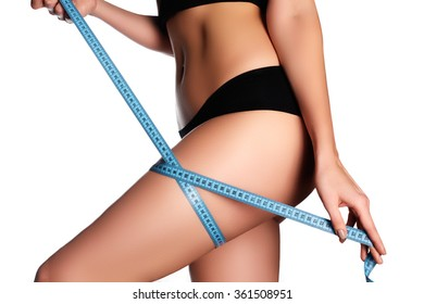 Woman measuring perfect shape of beautiful hips. Healthy lifestyles concept. Woman body part is being measured. Spa beauty part of body Healthy lifestyle,diet and fitness. Perfect waist, butt and legs