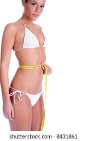 woman measuring waist after diet