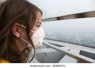 Woman in medical mask against the air pollution