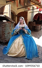 Woman in medieval clothes represents Anne Boleyn, second wife of King Henry VIII of England. Festival of retro costumes and historical reconstructions. History of the Middle Ages