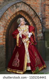 Woman in medieval clothes represents Anne of Cleves, fourth wife of King Henry VIII of England. Festival of retro costumes and historical reconstructions. History of the Middle Ages