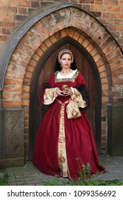 Woman in medieval clothes represents Catherine Howard, fifth wife of King Henry VIII of England. Festival of retro costumes and historical reconstructions. History of the Middle Ages