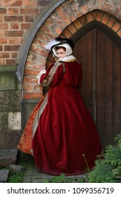 Woman in medieval clothes represents Catherine Parr, sixth wife of King Henry VIII of England. Festival of retro costumes and historical reconstructions. History of the Middle Ages