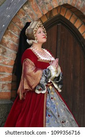 Woman in medieval clothes represents Jane Seymour, third wife of King Henry VIII of England. Festival of retro costumes and historical reconstructions. History of the Middle Ages