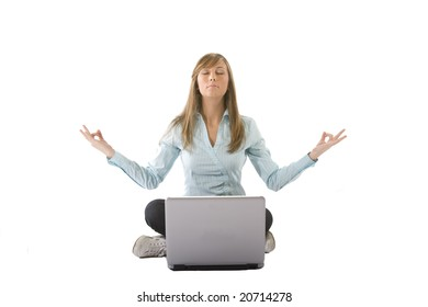 woman meditating in front of a laptop
