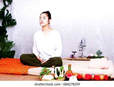 Woman is meditating at home