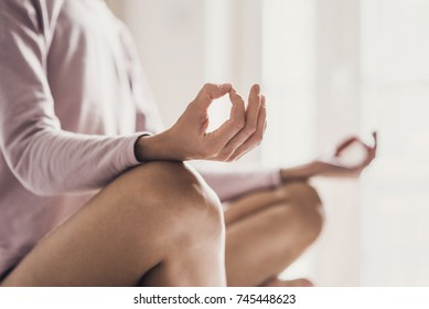 Woman meditating at home. Girl practicing yoga in yoga class
