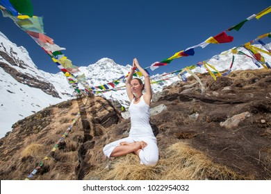 Woman is meditating in the mountains near Annapurna base camp