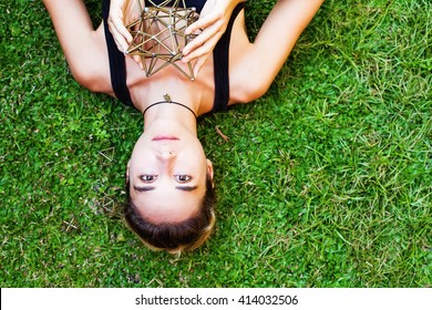 Woman meditating on sacred geometry