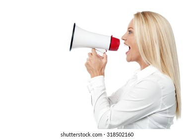 Woman with a megaphone making an announcement