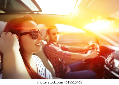 Woman and men in car and summer trip