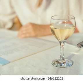 Woman with menu choosing dishes at restaurant.