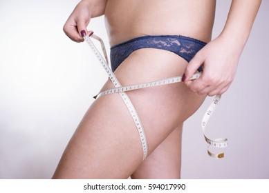 Woman mesuring buttocks