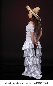 Woman in mexican costume hold revolver