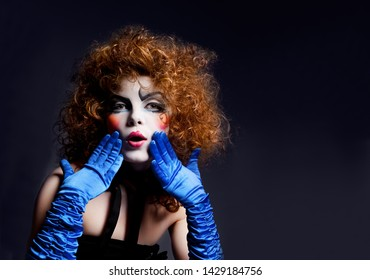 Woman mime with theatrical makeup. Studio shot.