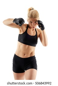 Woman MMA fighter throwing a hook isolated on white