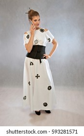 Woman with mobile phone, in a dress inspired by the Japanese kimono