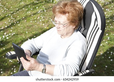 woman with mobile tablet outdoors