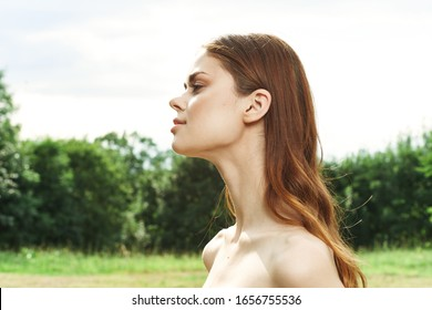 woman of model appearance in a forest grove