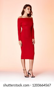 Woman model fashion style red skinny dress beautiful secretary diplomatic protocol office uniform stewardess air hostess business lady perfect body shape brunette hair wear suit elegance casual.