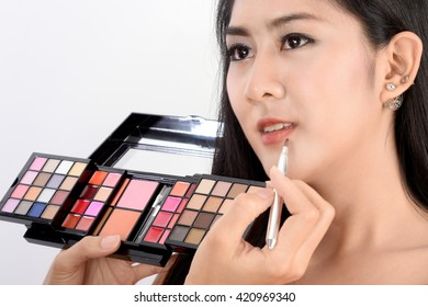 Woman model Lips and cosmetic professional makeup use lipstick brush