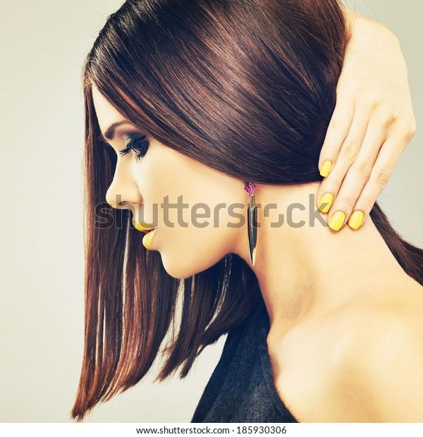 Woman model with long hair. Studio beauty.