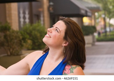 A woman model looking up.