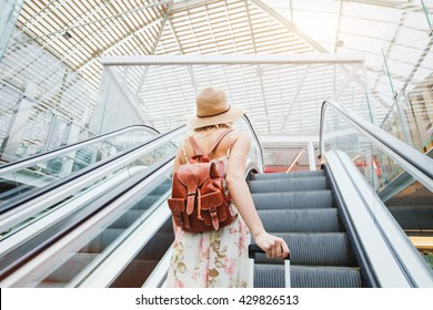 woman in modern airport, people traveling with luggage
