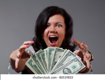 Woman and money. Focused on money.