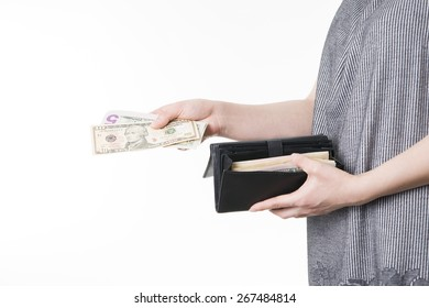 Woman with money in purse in hands on a white background
