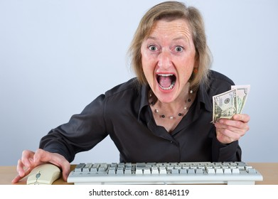 woman with money is screaming in to computer