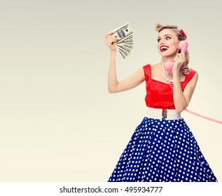 Woman with money, talking on phone, in pin-up style. Caucasian model in retro fashion and banking, finance, credit, sales and proposition concept. Copyspace area for advertising slogan, text message.
