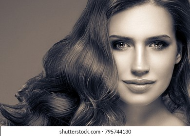 Woman monochrome portrait with beautiful hair and beauty skin. Black and white. Studio shot.