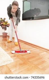 Woman mopping the hardwood floor