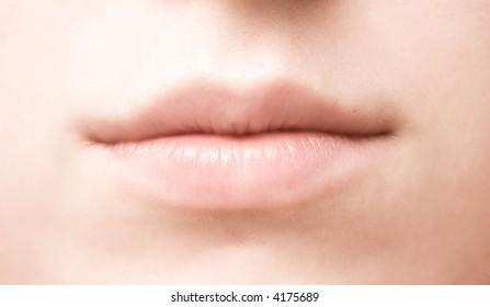 Woman mouth closeup. Soft colors.