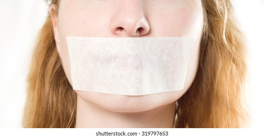 woman with mouth sealed