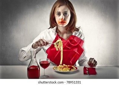 Woman mucking up her face while eating spaghetti
