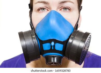 Woman in multi-purpose respirator half mask for toxic gas protection. Front view, isolated on white background