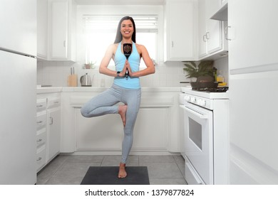 Woman multitasking alone in apartment kitchen, cooking and exercising yoga, mindfulness, balance, health