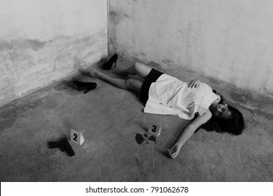 Woman was murdered scene sexual and raped in abandoned house marked with evidence condom,gun,blood black and white soft focus