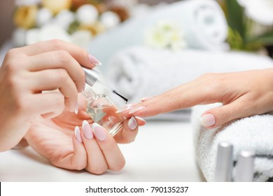 Woman nails manicure. Luxury nail design on beautiful woman hands. Top varnish care cosmetics in salon.