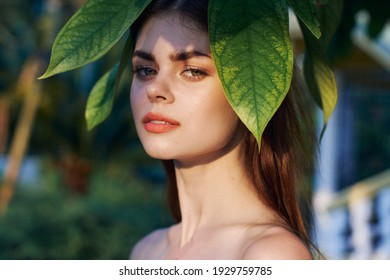 woman near green leaves palm tree clean skin cosmetology model natural look