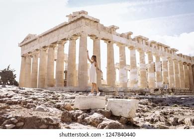 Woman near Parthenon temple and Acropolis in Greece. Woman like a goddess