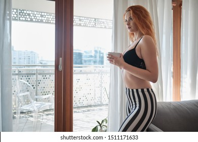 woman near window.Dream and relax