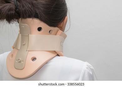 Woman with neck ache has a philadelphia collar