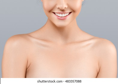 Woman neck shoulder lips nose gray background