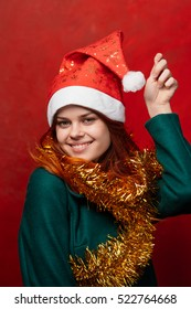 The woman in the new year. New clothes. Brightness and tinsel