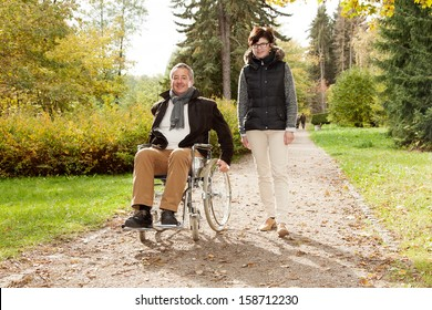 Woman next to man in wheelchair
