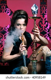 Woman in nightclub with hookah