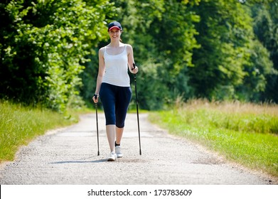 Woman with Nordic walking